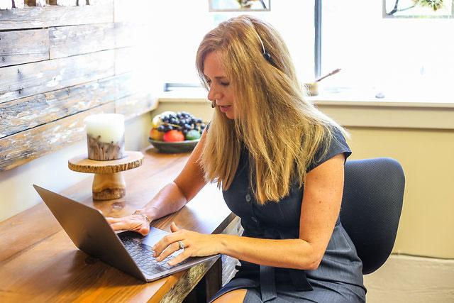 Jill Larson on Computer